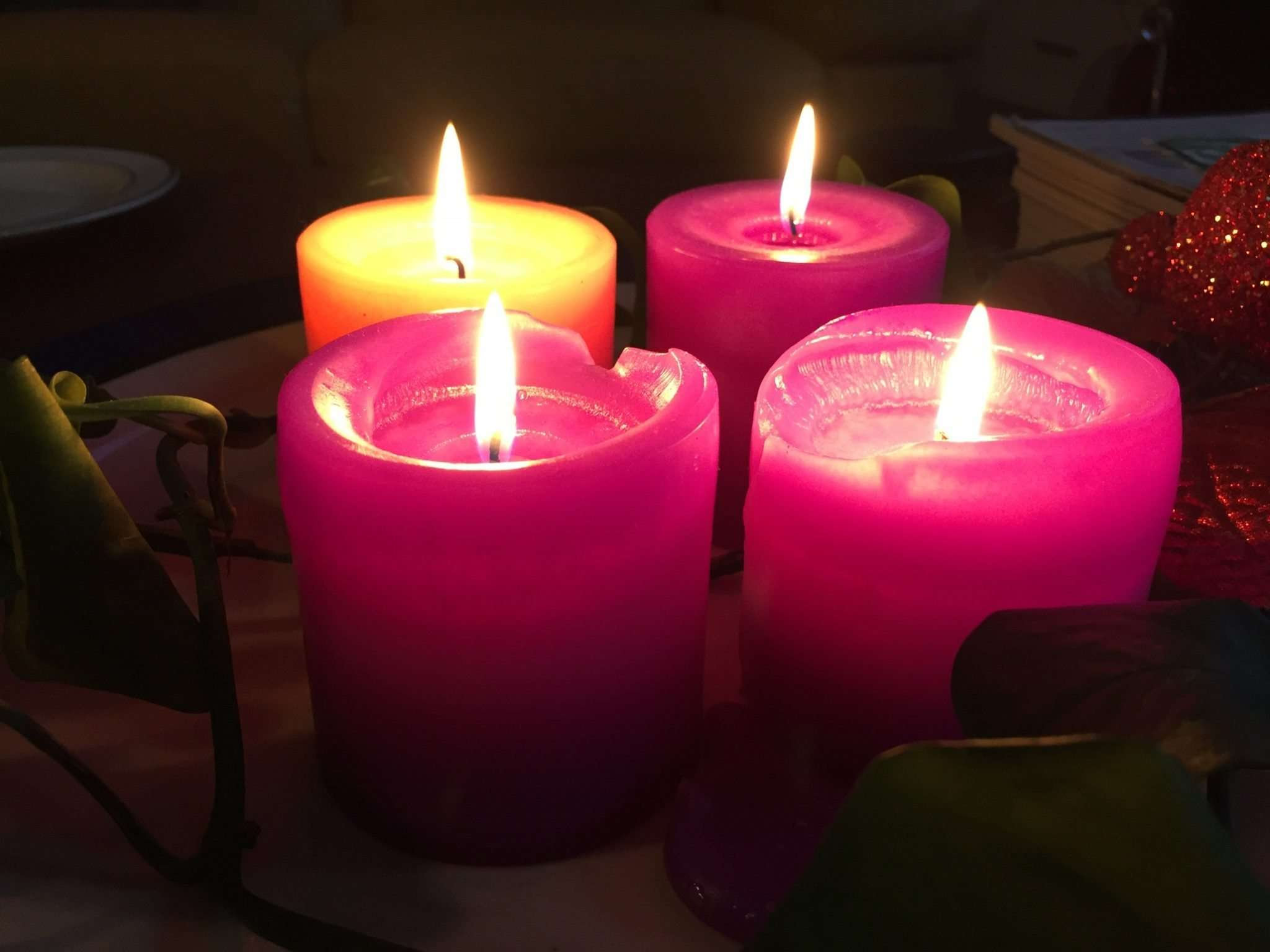 Advent wreath week four - three purple candles and rose coloured candle are lit.